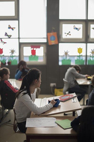 Girl in sunlit classroom