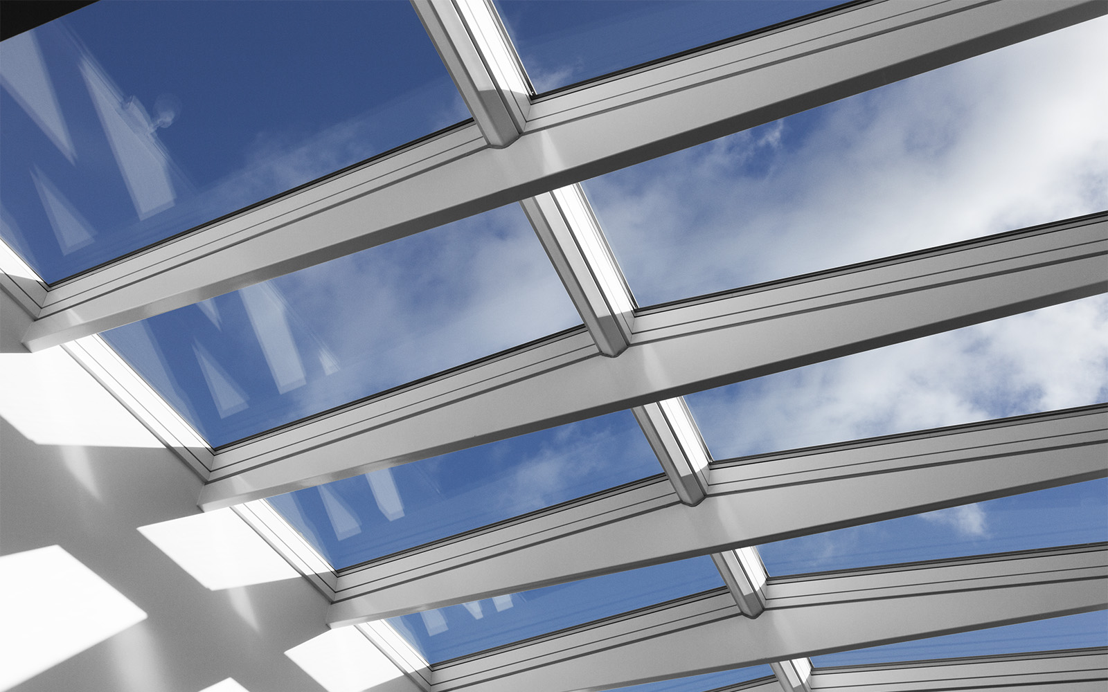 Clear blue sky view through roof skylights