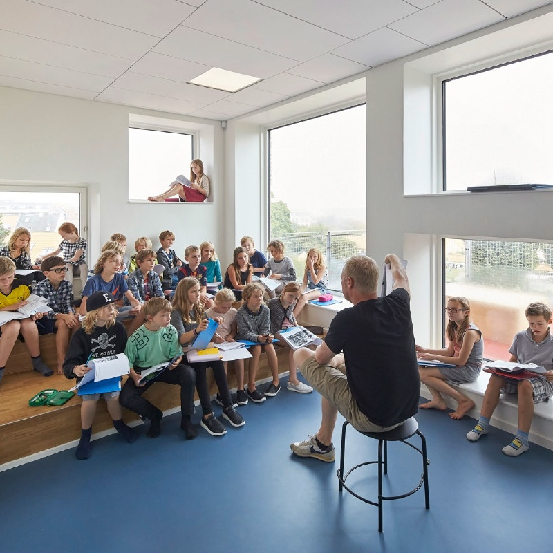 Classroom filled with natural light and modern seating arrangement